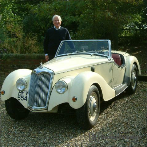 Karl Ludvigsen with his 1953 Riley 2.5L that was specially modified as a two-seater sports car in Scotland by Dennis Ramsay.