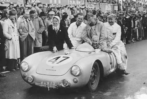 Zora's wife Elfi joins Zora and crew in celebrating 1954 class win at Le Mans in a Porsche 550.