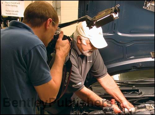 Bentley technical editors removing Valvetronic motor on N51 engine.