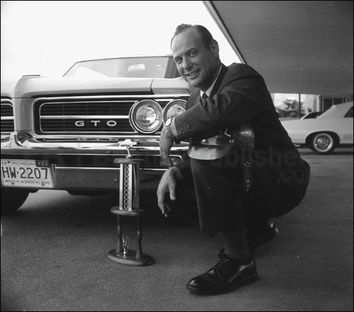 Jim Wangers poses with a '64 Goat