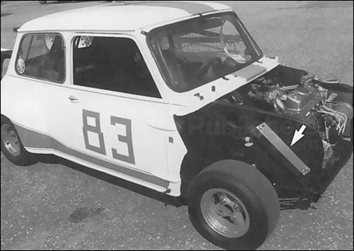This Mini is a former SCCA racer, modified with fully-removable clip-on hood and fender flares. Note location of oil cooler in wheel well.