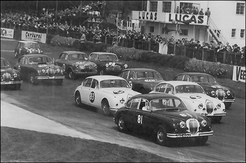 Jaguar Mark II was a popular racer in England and Europe from the beginning. This saloon car race in England is circa 1962.