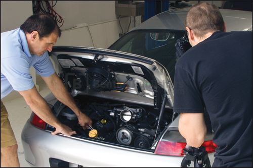 Bentley technical editors removing drive belt prior to servicing a 3.6 liter Carrera coupe.