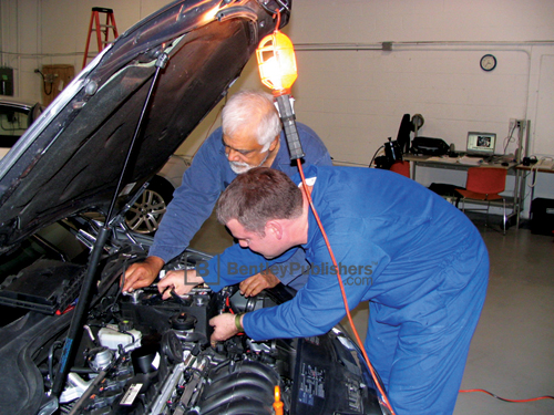 Bentley technical editors working on a 2005 Jetta.