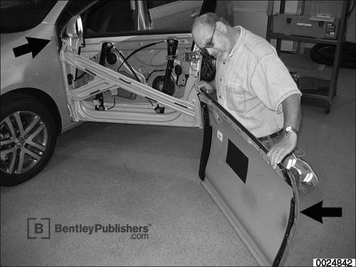 Outer door panels are removable for servicing components inside door cavity.