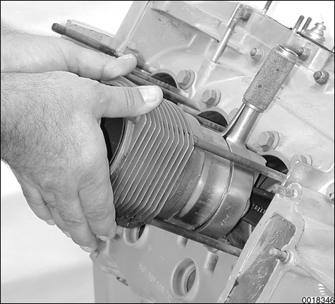 Detailed illustrations for each repair procedure, including use of special tools. Cylinder installation procedure shown using piston ring compressor.