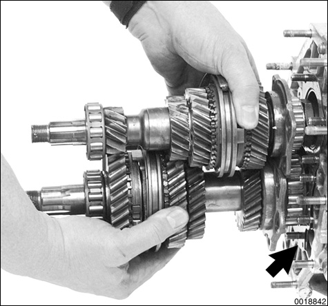 Slide shafts with gears and forks out of differential housing, leaving 1st - 2nd gear selector rod in transmission case.