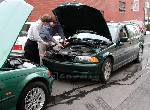 Bentley technical editors comparing features on E46 models